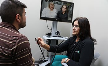 ecare provider connecting with patients via video
