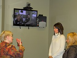Deanna Larson and Deb Fischer-Clemens explain the eCARE services to Rep. Kristi Noem