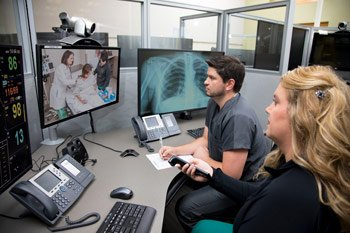ecare providers in front of computer screens providing virtual care